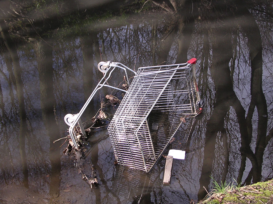 Shopping trolley dumped in the river.